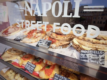 Neapolitan Street food stand. Calzone fritto Pagnottiello and Pizza among the traditional dishes offered for sale.jpg