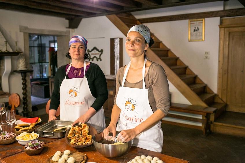 Show item 1 of 8. Women preparing food in a kitchen in Cagliari