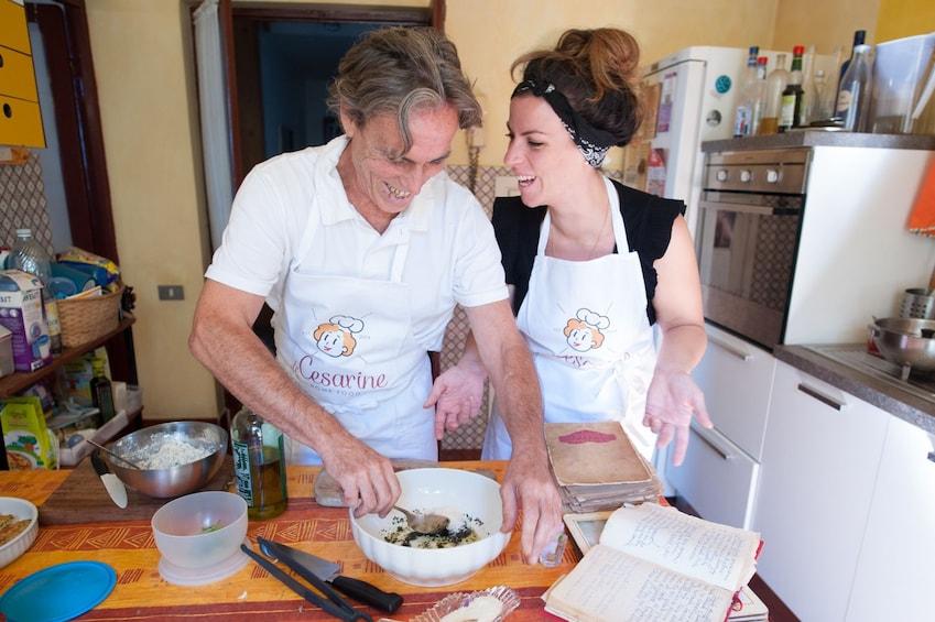 Show item 1 of 6. People cooking in La Spezia