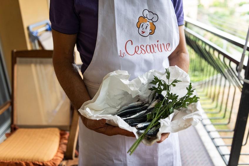 Show item 5 of 6. Private Market tour + Cook + Dine at local home in La Spezia