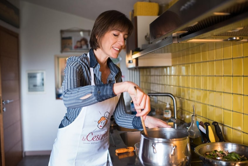 Show item 4 of 7. Private Market tour + Cook + Dine in a local home in Modena