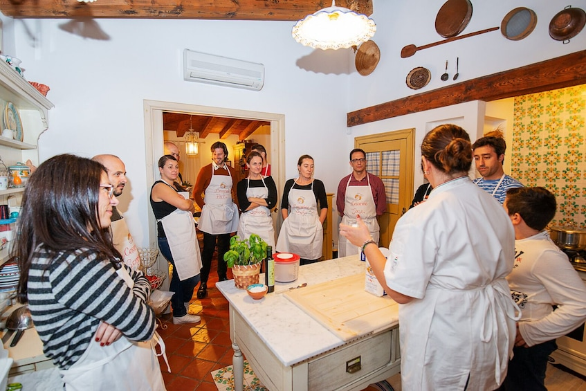 Show item 3 of 7. Private Market tour + Cook + Dine in a local home in Modena