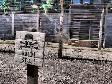 Danger sign outside the barbed wall of Auschwitz Birkenau Museum