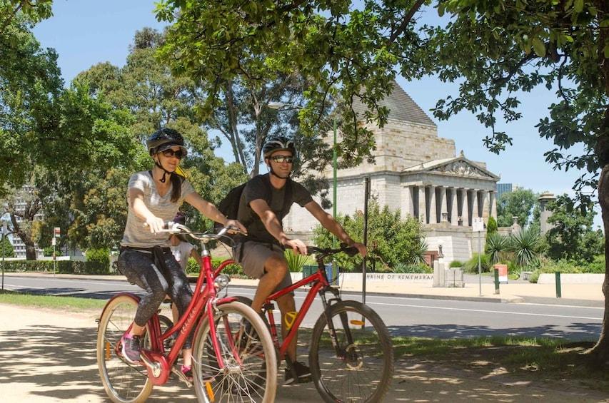 Show item 3 of 8. Couple enjoying a biking tour in Melbourne