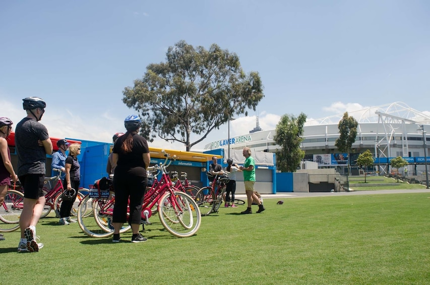 Show item 5 of 8. Bike tour group outside of the Rod Laver Arena in Melbourne, Australia
