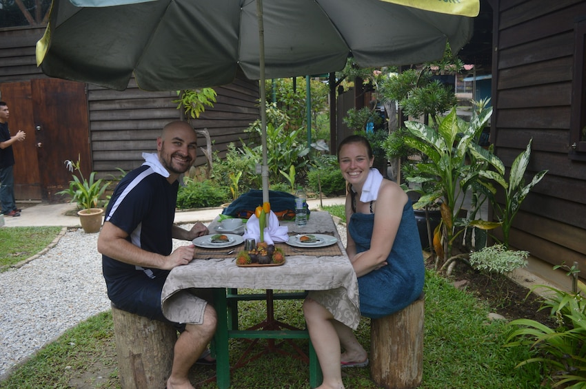 Show item 2 of 9. Couple eating at a picnic table on Langkawi Island