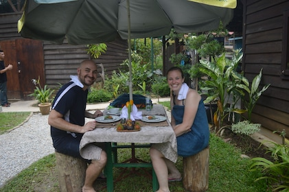 Couple eating at a picnic table on Langkawi Island