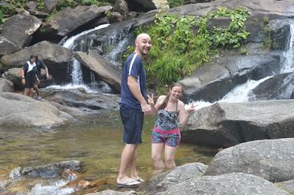 Couple wading in a waterfall pool on Langkawi Island