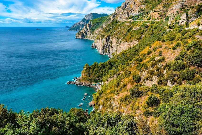 Show item 5 of 10. Lush cliff sides on the Amalfi Coast in Italy