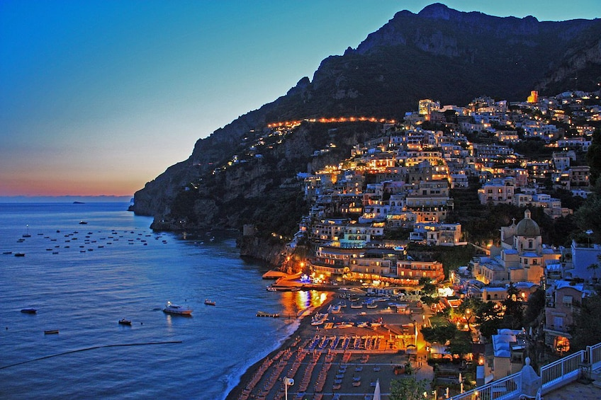Show item 1 of 10. Coast of Positano, Italy at sunset