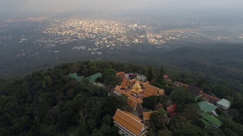 videoblocks-aerial-scene-of-zoom-out-from-temple-on-the-mountain-doi-suthep-chiang-mai-chaing-mai-thailand-4k-video_r3ml5-so7m_thumbnail-full01.png