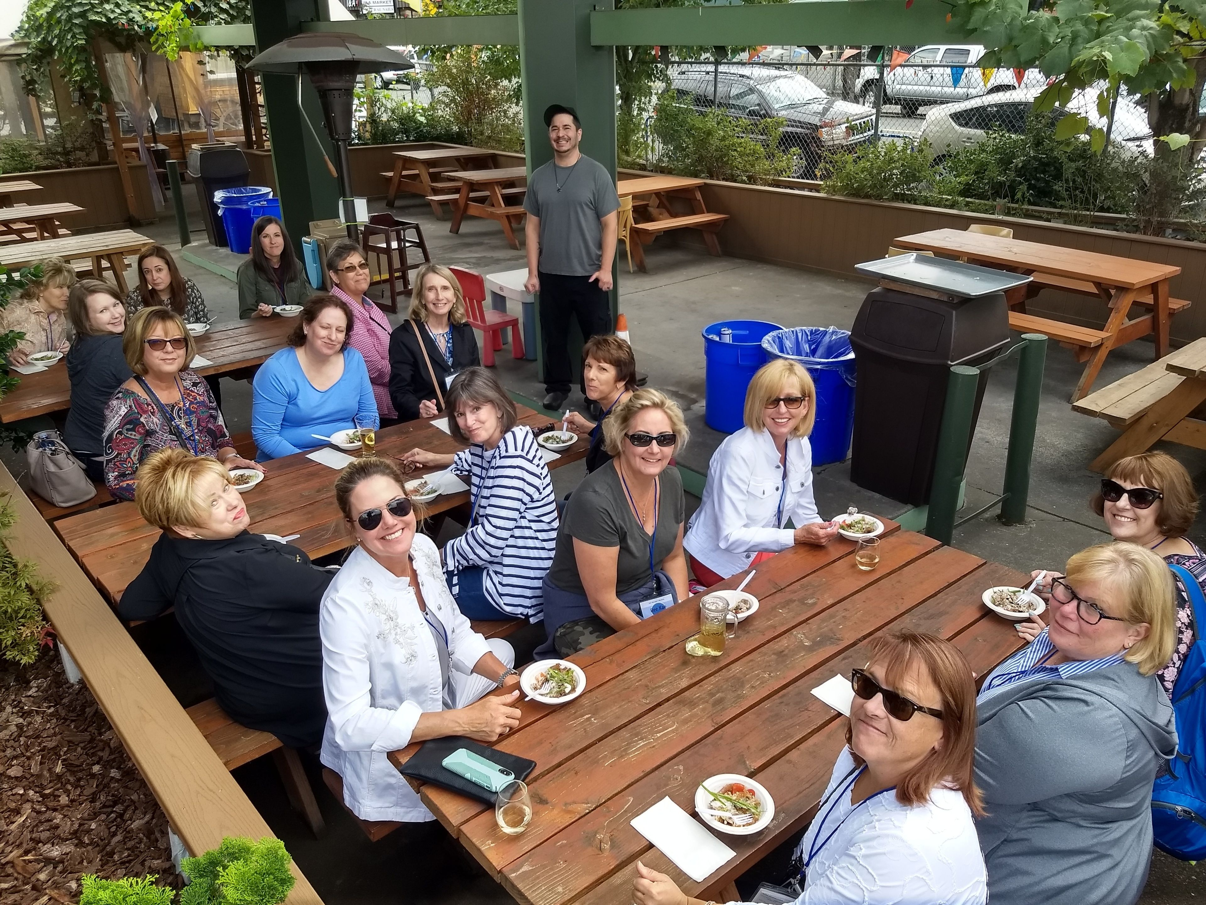 Food tour sitting at picnic tables in Portland