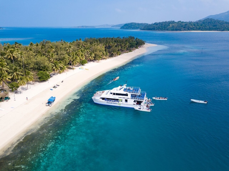 Show item 3 of 8. Boat anchored at a small island in Fiji