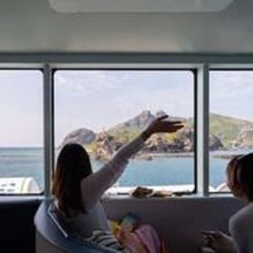 Cruise boat passengers looking out at an island in Fiji