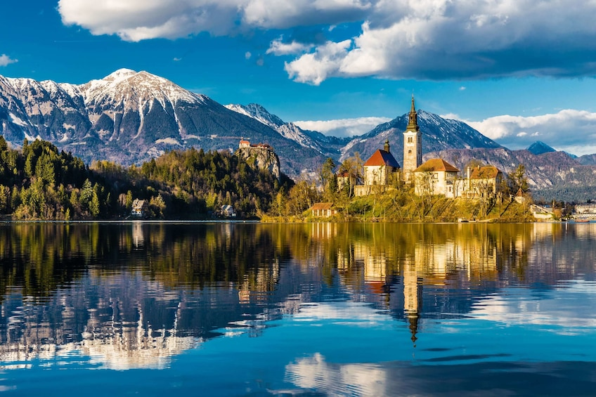 Show item 3 of 4. Island in Bled Lake with mountains in background
