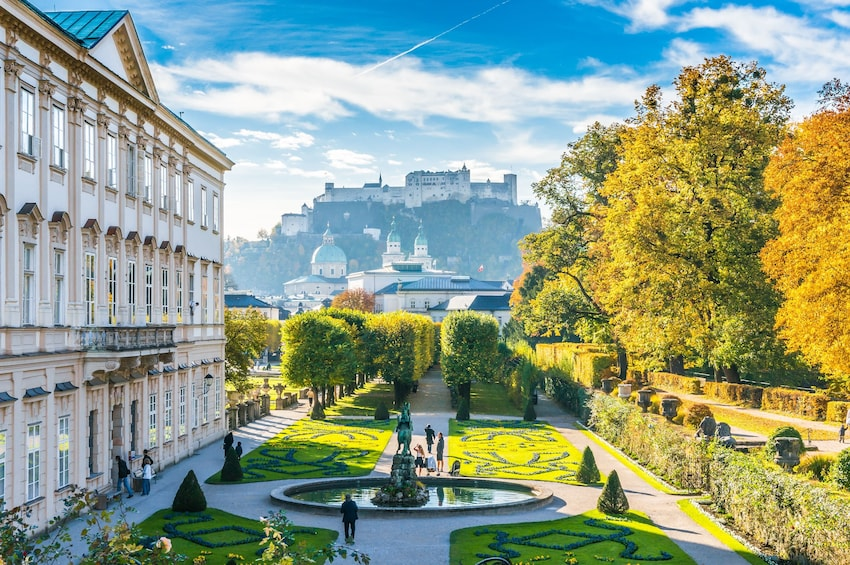 Show item 2 of 3. Famous Mirabell Gardens with Fortress Hohensalzburg in the background