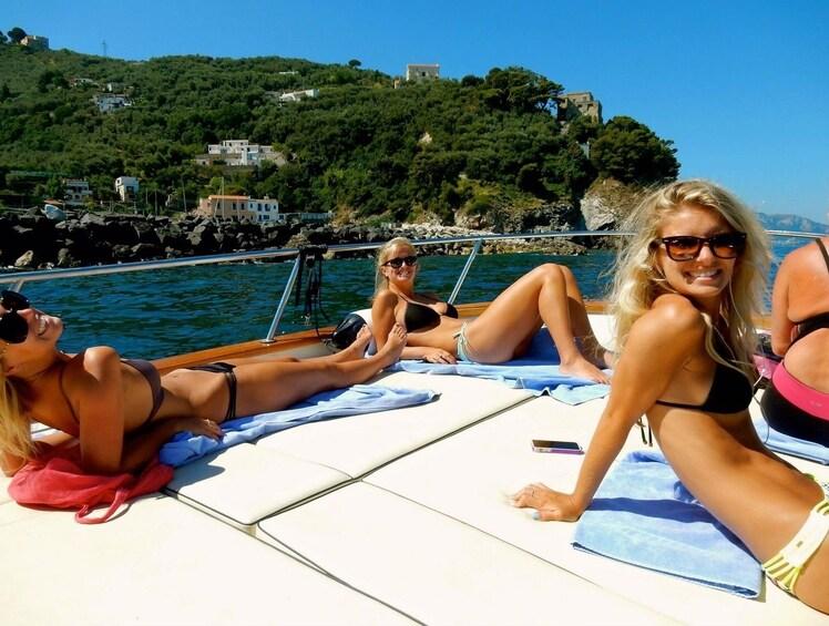 Show item 2 of 10. Tourists sunbathing on a boat floating along the Amalfi Coast