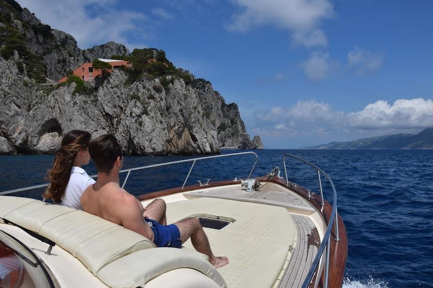 Show item 3 of 10. Couple enjoys relaxing boat tour along the Amalfi coast