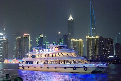 Boat and city at night in Shanghai