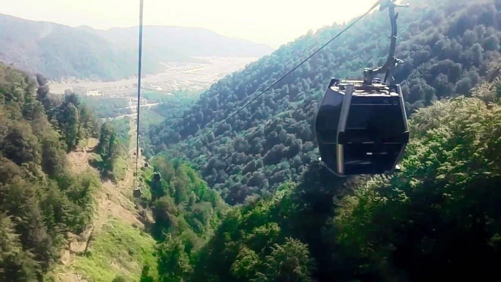 Show item 2 of 9. Gabala Cable Car high over the forest