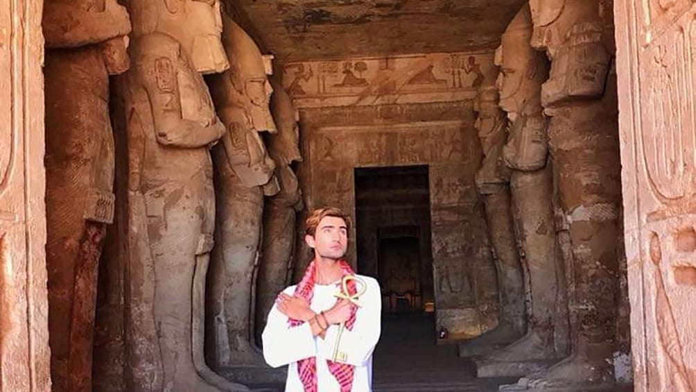 Show item 3 of 6. Man poses in threshold of Abu Simbel Temples in Aswan, Egypt