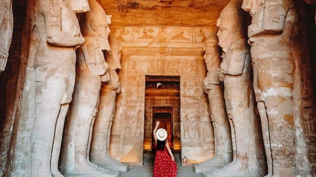 Show item 1 of 6. Woman poses in front of doorway to Abu Simbel Temples with statues on either side