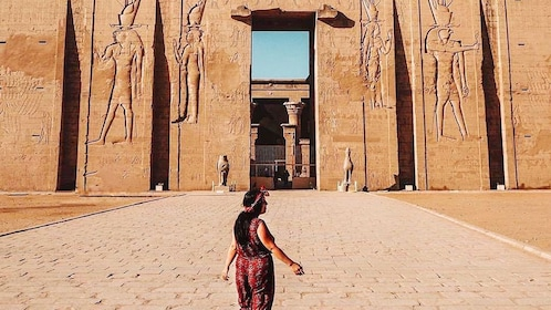 Woman poses in front of Temple of Horus at Edfu