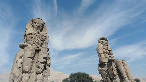 Colossi of Memnon on a clear day in Luxor, Egypt