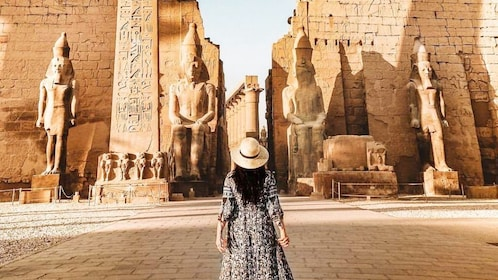 Woman stands in front of Temple Complex in Egypt