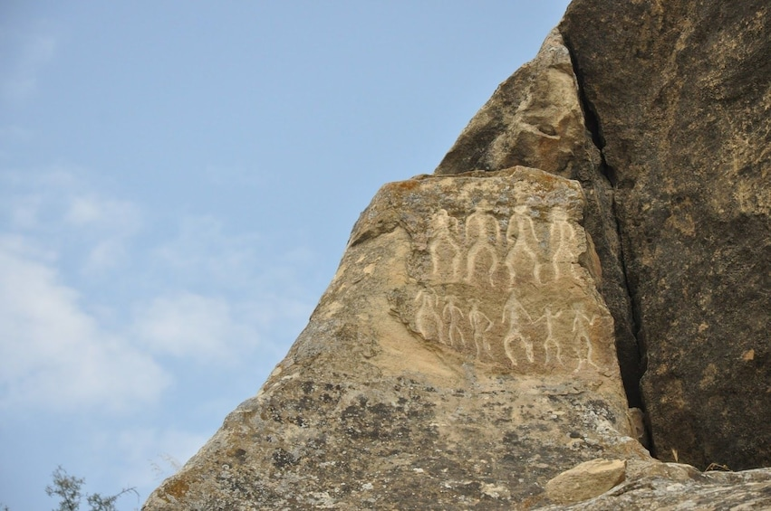 Show item 3 of 8. Cave paintings in Gobustan National Park