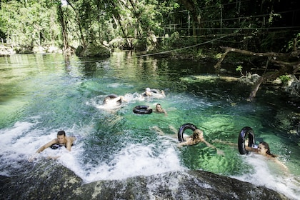 Group swimming at Eden on the River in Port Vila