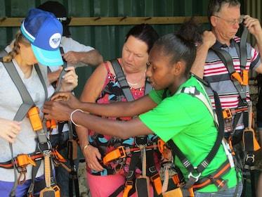 Group putting on zipline gear at Eden on the River in Port Vila