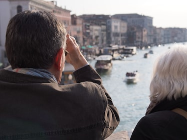 Tourists sightseeing along the Venice canal