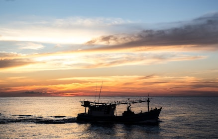 Panoramic view of boat on water in Vietnam at sunset