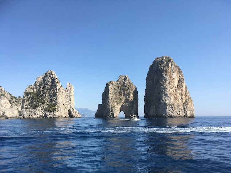 Show item 3 of 10. Faraglioni rock stacks in sea near Capri, Italy
