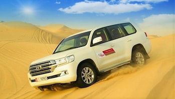 Desert Safari with Dune Bashing & BBQ Dinner in Abu Dhabi