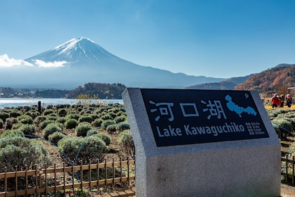 Sign for Kawaguchi Lake with lake and Mt. Fuji in the background