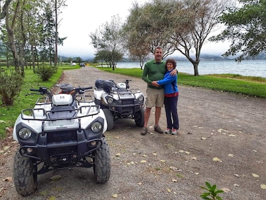 Couple hugging each other next to some ATVs in Sete Cidades