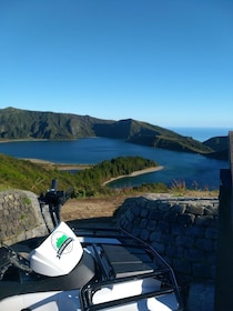 ATV parked next to Lagoa do Fogo crater lake in Portugal