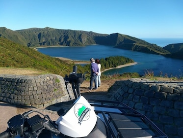 ATV riders looking out at Lagoa do Fogo crater lake in Portugal