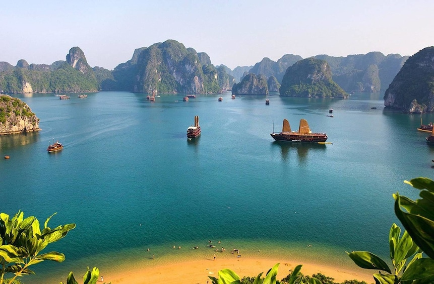 Show item 5 of 10. Aerial view of beach and boats in Halong Bay