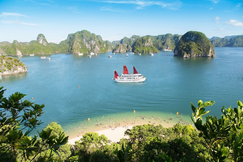 Show item 3 of 10. Aerial view of cruise ship on Halong Bay and beach on a sunny day