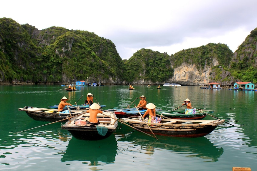 Show item 2 of 10. Bamboo boats meet in a circle on Halong Bay