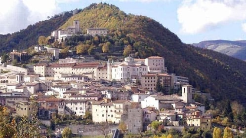 Buildings on a hillside in Cascia, Italy