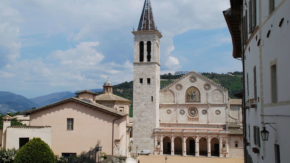 Show item 3 of 10. Spoleto Cathedral on a cloudy day in Spoleto, Italy