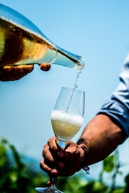 Champagne being poured for a tasting at a vineyard in Reims