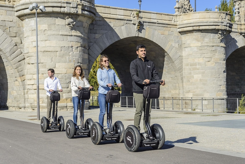 Show item 1 of 11. Day view of a group on a segway tour in Madrid, Spain