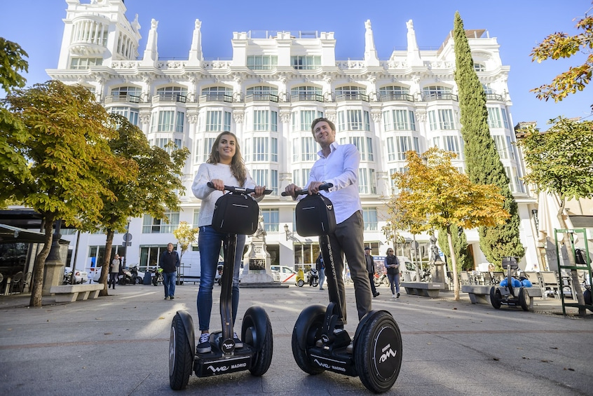 Show item 2 of 11. Couple enjoying a segway tour in Madrid, Spain
