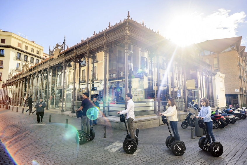 Show item 3 of 11. Segway tour group passing by San Miguel Market in Madrid, Spain