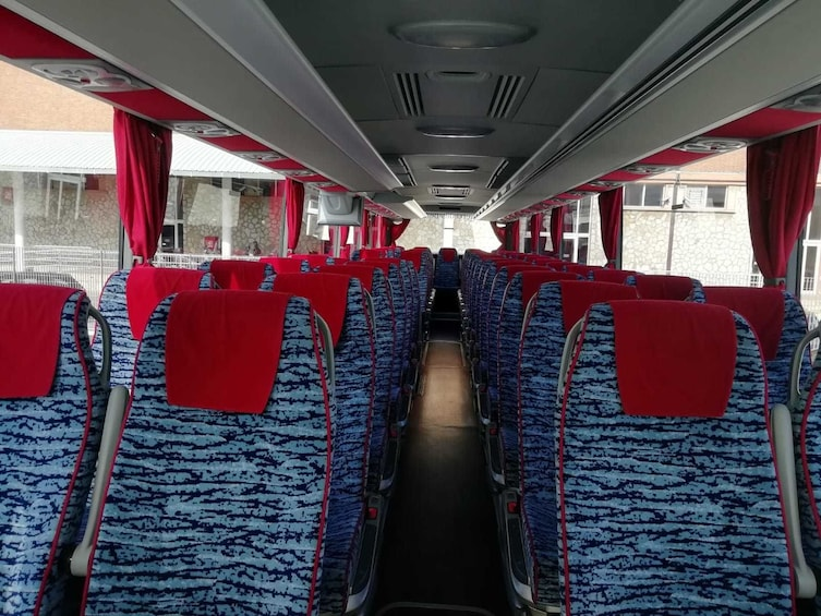 Show item 4 of 10. Rows of seats inside of shuttle bus